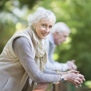 Senior couple, aged 67 and 69, outdoors together in a park